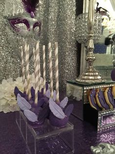 Purple feather treats at a masquerade Quinceañera party! See more party planning ideas at CatchMyParty.com!