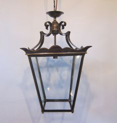 European four sided lantern in the original patinated brass finish complete with period glass with a subtle undulating surface. c 1920  www.antiquelightingcompany.com
