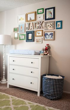 Cluster of prints above changing table ie in kid's room