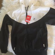 Nike windbreaker NWT Nike windbreaker. Size says XL but it fits like an XS, S, or M. LOOKING TO TRADE FOR VS PINK OR NIKE!!!!!! Nike Jackets & Coats