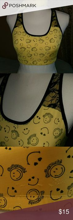 Smiling sexy lace sports bra black and yellow Razer back sports bra tried on to small for me small snag on front picture #3 shows other then that great condition Intimates & Sleepwear Bras