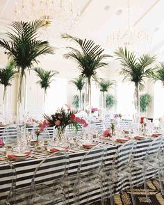 A Fun, Floral Bridal Shower in Washington, D.C. | Martha Stewart Weddings - Two long tables covered with navy-and-white striped cloths were balanced by the ballroom's neutral white walls. Grit and Grace and DC Rentals mixed things up at the place settings, using bold china patterns and gold cutlery to complete the lunch set up.