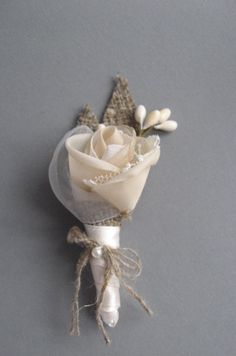 Wedding accessory groom boutonniere burlap rustic woodland beige tan rose burlap twig groomsmen. $19.00, via Etsy.