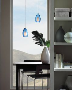 Fire from Tech Lighting is comprised of a rich, translucent Murano glass shade surrounding a frosted raindrop glass.  The Fire adds modern charm to any dining room, living room, or open space.  It is offered in amber, cobalt, Havana brown, red, smoke, and steel blue color options.  Antique bronze, chrome, and satin nickel finishes are available. www.luxurylightingdirect.com