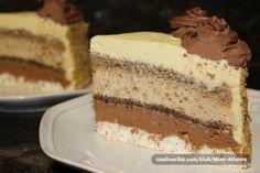 Torta u kojoj se nalaze svi moji omiljeni sastojci:kokos,cokolada,orasi i rum...Tanke kore a dosta fila...jako,jako kremasta...