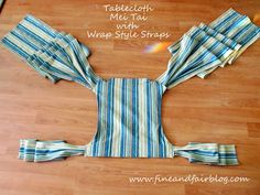 This TCMT tutorial will show how to make a Mei Tai Baby Carrier with wrap-style straps from a table cloth!