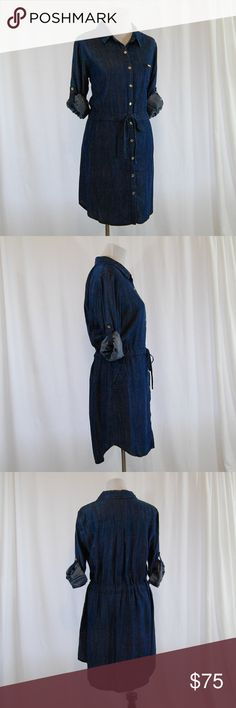 """Tommy Hilfiger Denim Drawstring Dress (NWT) Brand new with tags Retail = $129  Super soft blue """"denim""""-look dress. Silver buttons along entire front center  Tie / drawstring waist Button up style  Full sleeve with attached buttons and flaps to roll up and secure sleeves  Unlined Collar Single breast pocket   100% Lyocell  Approximate measurements (taken flat): Bust (armpit to armpit) = 22"""" Length = 35-37"""" (curved hem) Sleeve (uncuffed) = 26""""  <BL89> Tommy Hilfiger Dresses"""