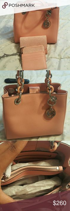 Michael Kors Cynthia Purse and Wristlet Wallet set Brand new bag and wallet. This is gorgeous Pale Pink woth Silver hardware. The purse also includes the long strap. Dustbag included. Michael Kors Bags