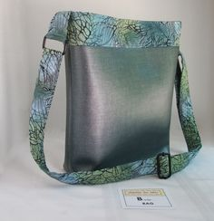 CROSSBODY Handbag in Aqua Blue and Lime Accent Fabric with Silver Grey Faux Leather . . . $65 . . . by #SEWINGtheABCs on #Etsy . . . BUY IT NOW! or PIN IT to FIND IT Later . . . #CrossbodyBag #SilverHandbag #BlueCrossbodyBag #SilverCrossbodyBag #ShoulderBag #MediumCrossbodyBag #HandcraftedCrossbodyBag #Handcrafted #FauxFabMix #FauxLeather #SilverFauxLeather