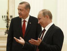 Putin  gestures after greeting Turkish Prime Minister Tayyip Erdogan