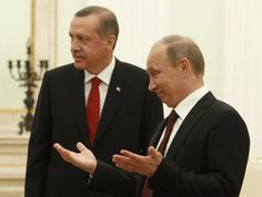 Putin  gestures after greeting Turkish Prime Minister Tayyip Erdogan