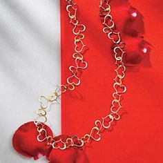 Intertwined-Hearts-Necklace - and there's a matching bracelet and earrings.  Just too cute!