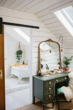 A plain old attic has been turned into this beautiful rustic master suite.