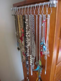 AFTER...close up! LOVE! LOVE! I found necklaces I forgot I had, very easy access to them now. Less then $10.00, Drapery rod, Metal shower rings, Command damage free hanging strips. (my version)