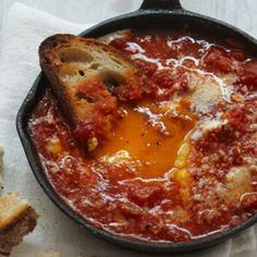 One of the cheapest meals in existsnce. Nigella Lawson's Eggs in Purgatory. Also healthy, and most cheap food isn't healty. This one is top notch. You can use fresh tomatoes and stew them yourself if you don't like canned veggies. Breakfast For Dinner, Breakfast Time, Breakfast Dishes, Breakfast Recipes, Breakfast Quiche, Breakfast Ideas, I Love Food, Good Food, Yummy Food