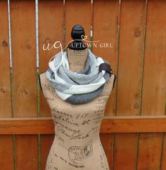 Cozy up in this winter knit scarf, this scarf will keep you warm on the coldest of days. This is a beautiful knit infinity scarf that will look fantastic with any outfit. Wrap your neck up in this beautiful scarf for warmth and style. Try wearing this with a leather cuff for a stylish new look.