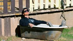 Zak does some sunbathing in an old bath tub on the main street of Bonnie Springs.