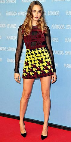 Last Night's Look: Love It or Leave It? Vote Now! | CARA DELEVINGNE | wearing a  Mary Katrantzou top and skirt with black heels and deep wine lips to a Berlin photocall for her film Paper Towns.