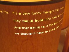 Lazer engraved wooden lamp shade...in English, via Flickr.