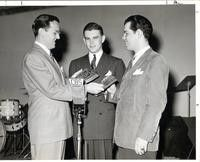 Glenn Miller and Dave Dexter presenting a Downbeat award to Tex Beneke