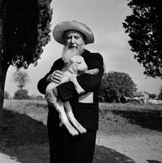 "thephotoregistry:  "" Farmer with lamb, Italy, 1955  Bill Perlmutter  """