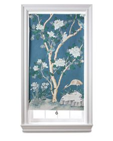 A length of wallpaper is all it takes to turn a plain roller shade into a work of art -- complete with its own frame.