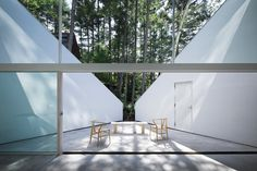 """A summer house in Nagano, Japan """"situated on a flat site which does not have the vantage point for sweeping views. The design carves out a triangular plane into the structure's form to extend the eyes obliquely up towards the sky."""" By Ozeki Architects & Associates."""