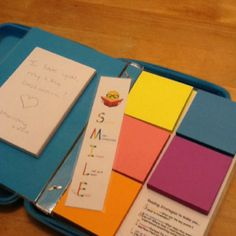 Inside of reading kit...post-its are color-coordinated to the Smile strategy they promote...summarizing key points, making a connection, imagining the scene, words for look-up, or remembering what she loves!