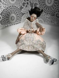 HOW WOULD I DESCRIBE THIS ? WELL, SHE LOOKS LIKE A DRUG CRAZED GAL DRESSED LIKE A VOODOO DOLL. China Fashion Week