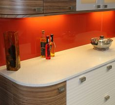 The effect of wood effect doors with the white, is lifted further by the pop of bright, happy orange!