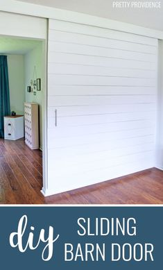 This DIY sliding barn door painted white is perfect DIY project for modern and farmhouse decor! Diy Barn Door Plans, Diy Sliding Barn Door, Sliding Wall, Barn Doors, Sliding Doors, Living Room Color Schemes, Living Room Designs, Cheap Home Decor, Diy Home Decor