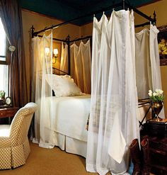 bedroom with a romantic canopy bed