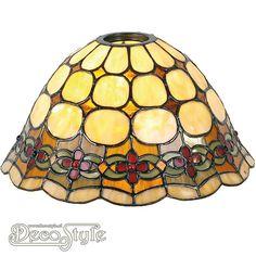 Tiffany Kap Tremus (26CM)  Losse Tiffany kap. Helemaal vervaardigd met echt Tiffanyglas. Dit originele glas zorgt voor de warme uitstraling. Afmetingen: Hoogte: 15 cm Diameter: 26 cm De kap heeft een opening van 6 cm voor kaphouder en fitting.