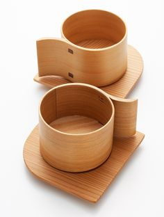 """Created by designer Yukio Hashimoto. The pieces are hand crafted using the traditional Japanese craft technique of """"wappa"""" or wood bending. Wooden boards are bent in hot water, creating beautiful curves"""