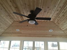 Inside view of screen room: Hip style roof, cedar tongue & groove ceiling, recessed lights & ceiling fan