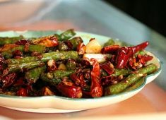 In this recipe for Szechuan Beef, the meat is dry-fried until it is chewy crispy, and then stir-fried with spicy seasonings and vegetables.