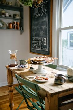 Wood table, window light, pie setting, autumn decor, framed chalkboard.
