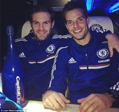 Juan Mata and Cesar Azpilicueta on the team bus after bagging a goal apiece.