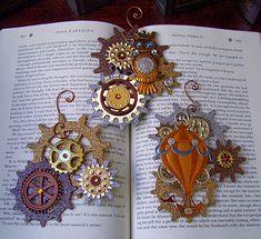 Steampunk ornaments....but I'm thinking of using them as bookmarks!  A lil' elastic here, a cog there....