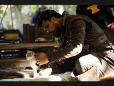 Musketeers, season 2, BTS. Porthos and a kitty. Courtesy of Jessica Pope on her twitter.