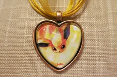 Flareon Pokemon necklace made from upcycled by CharmingSushi, £6.29