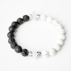 Yin & Yang Bracelet- brings balance to the wearer! Lava stone & howlite stone, accented with clear recycled glass & antique silver. #lava #yinyang #balance #recycled