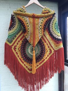 such a pretty hood on this crocheted poncho.