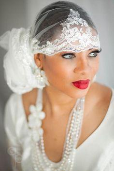 Lace veil tied like  a headscarf. veil