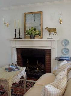 Tone on Tone: Collecting and Displaying Weather Vanes    mantel styling and I love the table & plates beside the fireplace.