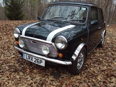 1976 Austin Mini Cooper. My first car was one of these but did not have the cool racing stripe