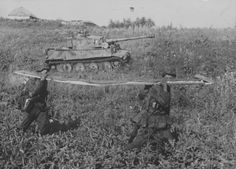 Photo of a Tiger Tank and soldiers from 2nd SS Panzer Division Das Reich at Kursk, July 1943