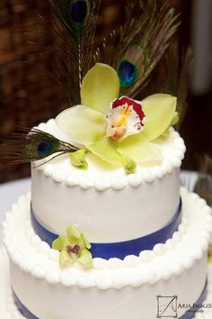 Our wedding cake by burgawbakery.com    #orchids #buttercream #peacock