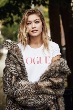 Gigi Hadid in Vogue graphic tee and fur coat
