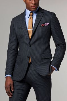 A unique alternative to the classic white pinstripe, this suit features a side-by-side mustard and cream pinstripe on deep gray fabric.